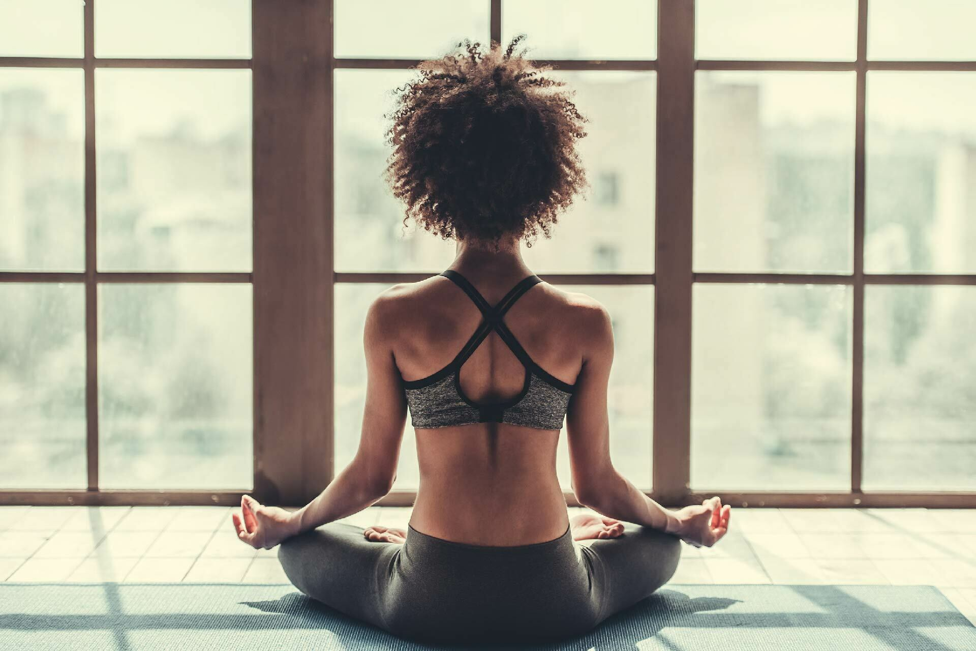 Woman Meditating in Yoga Studio