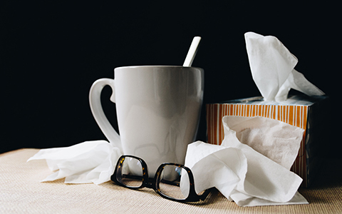 Tea, tissues and glasses on a desk