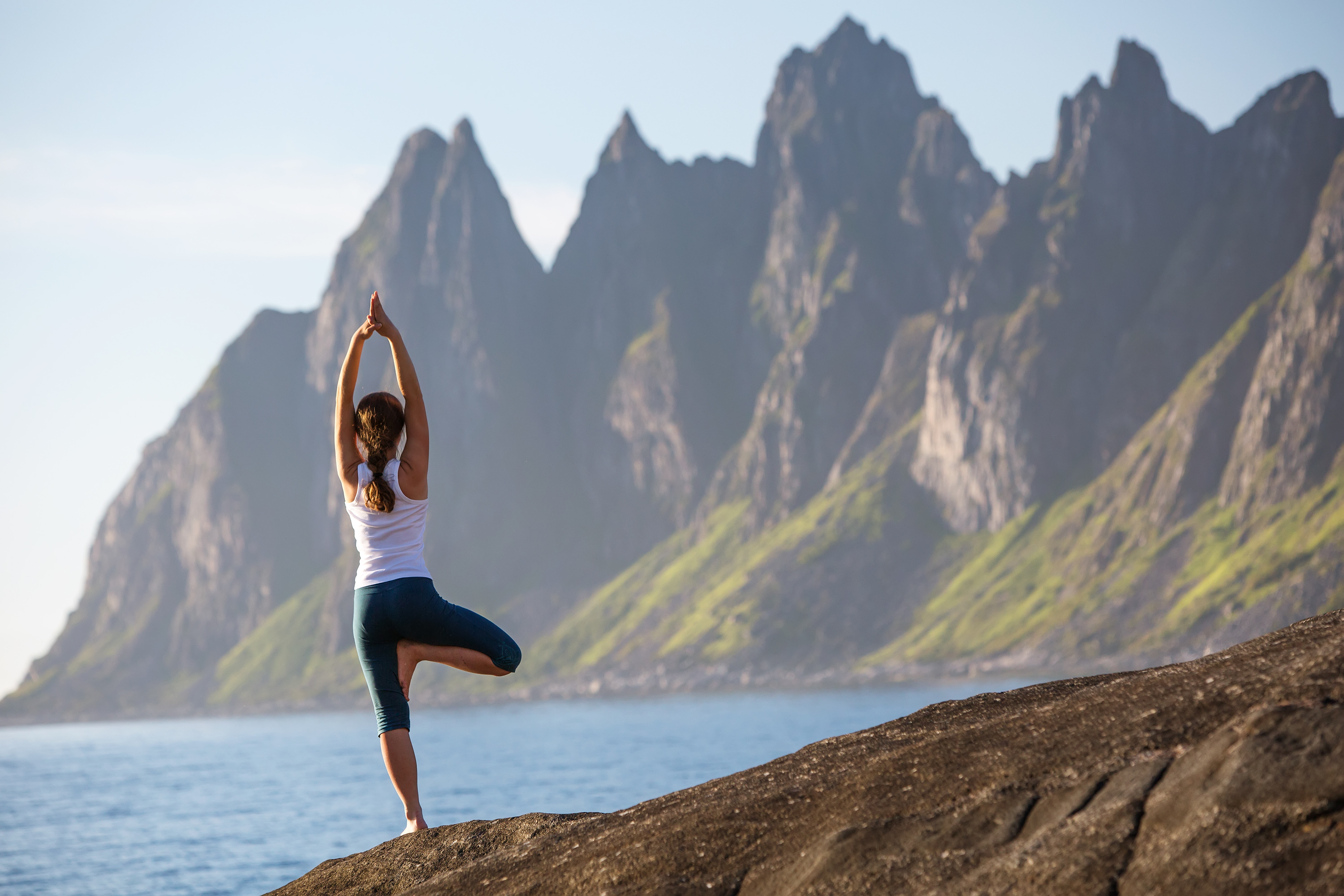 Woman Yoga Pose by the Sea